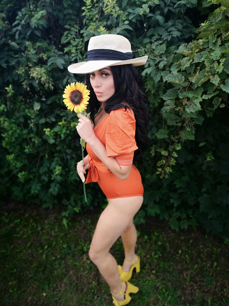 Nadia Dolce swimsuit orange tangerine quavino hat yellow heels woman